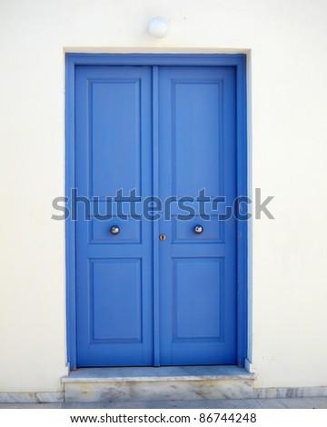 vibrant blue door, Mediterranean house - stock photo