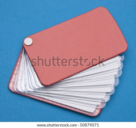 Vibrant business card holder filled with business cards. - stock photo