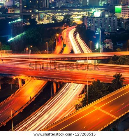 Vibrant cityscape at night - stock photo