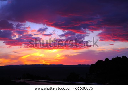 Vibrant cloudscape at sunset - stock photo