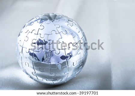 Vibrant Color Metal Puzzle Globe On Satin