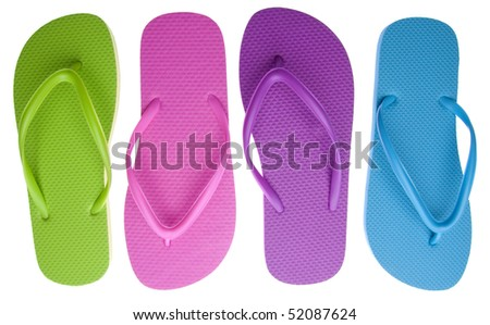 Vibrant colored summer flip flops isolated on white with a clipping path.