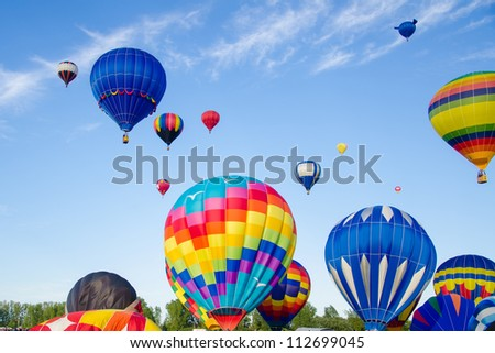 Many Beautiful Balloons In The Sky : ... , colorful, Hot air balloons float up into the sky. - stock photo