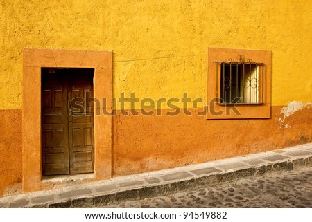 Vibrant colors on a building in downtown San Miguel de Allende - stock photo