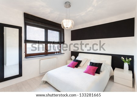Vibrant cottage - Bedroom interior with white bed - stock photo