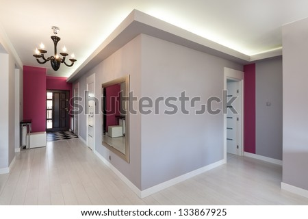 Vibrant cottage - grey corridor in modern house - stock photo