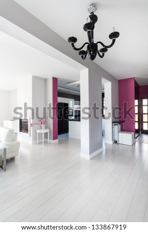 Vibrant cottage - hall, living room and a kitchen - stock photo