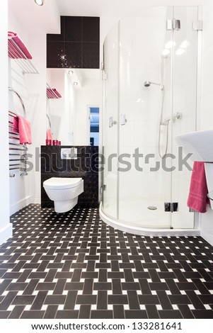 Vibrant cottage - Interior of a black and white bathroom - stock photo