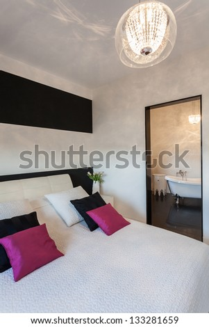 Vibrant cottage - Modern bedroom and a bathroom - stock photo
