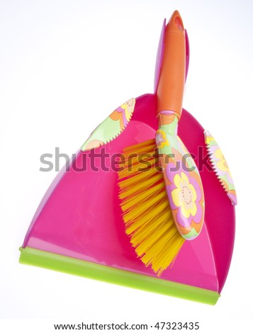 Vibrant dust pan and sweeper for spring cleaning.  Isolated on white with a clipping path.