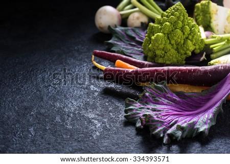 vibrant fresh vegetables on slate background - stock photo