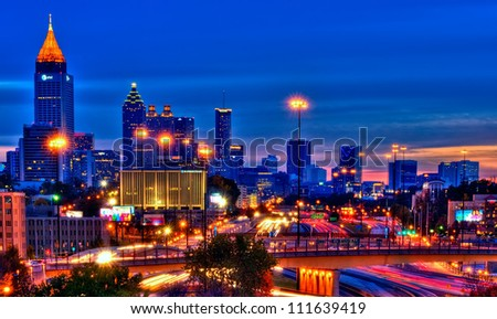 Vibrant HDR of Atlanta at night  using 5 long exposures to generate traffic trails. Editorial use,  no editing of logos or signs. - stock photo