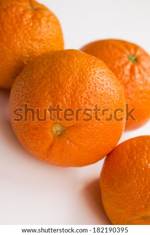 Vibrant mandarin fruit on a white background.