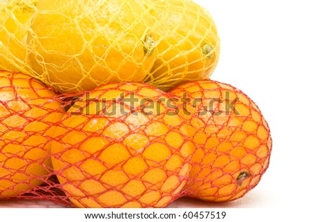Vibrant Oranges and Lemons from low perspective isolated against white. - stock photo