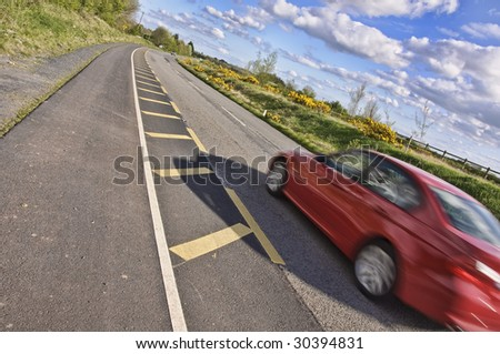 vibrant picture of car going for drive in countryside - stock photo