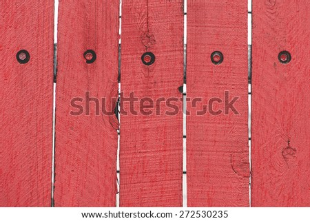 Vibrant red antique wooden wall with screws background