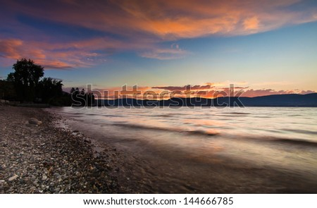 Vibrant Sunset by the lakeshore - stock photo