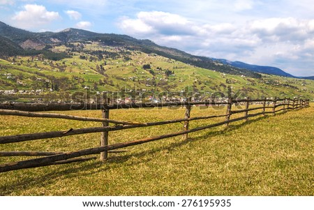 Vibrant wooden countryside fence in the Carpathian mountains - stock photo