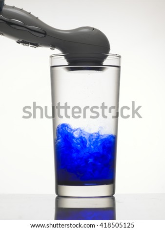 Vibration makes the blue color in water splitting.   - stock photo