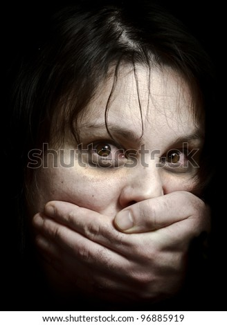 Victim of violence. Focus on the eyes. High contrast. - stock photo