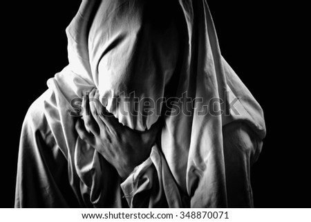 victim with his face covered - stock photo
