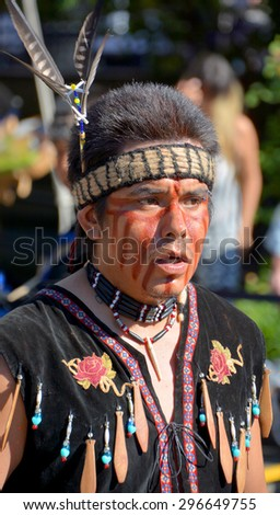 VICTORIA BC CANADA JUNE 24 2015: Native Indian man in traditional costume. First Nations in BC constitute a large number of First Nations governments and peoples in the province of British Columbia