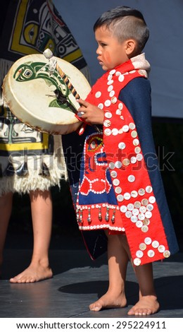 VICTORIA BC CANADA JUNE 24 2015: Native Indian unidentified child in traditional costume. First Nations in BC constitute a large number of First Nations governments and peoples in the province of BC - stock photo