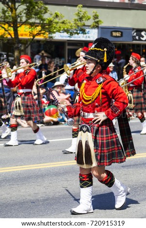 Victoria BC Canada May 22,  2017: Scotties Pipe Band marching on the Victoria Day parade. This is Victoria's largest parade and attracting well over 100,000 people from Canada and the USA..