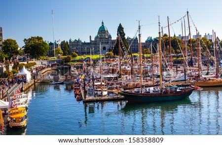 VICTORIA, BRITISH COLUMBIA - AUGUST 31, 2013 Provincial Capital Legislative Buildiing Wooden Boats Inner Harbor British Columbia Canada on August 31, 2013. - stock photo