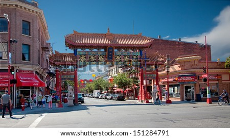 VICTORIA, BRITISH COLUMBIA, CANADA - JULY 7: The Victoria's Chinatown gate,  known as The Gates of Harmonious Interest shot on July 7, 2013 in Victoria, British Columbia, Canada.  - stock photo