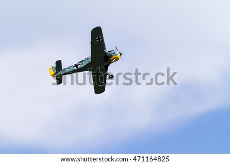 VICTORIA CANADA - AUG 13 2016: Victoria's Largest Little Air Show. WW II. Air Force Model airplane high above the  airport in the air.  Airshow promises to be fun for the whole family.