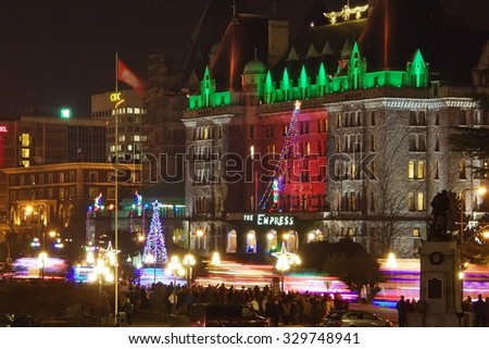 Victoria, Canada-DECEMBER 3, 2011: Victoria city downtown during Christmas lighted truck Parade. Lighted trucks pass the Empress hotel and light up the harbour with their horns and lights.