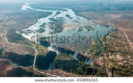 Victoria falls on helicopter. Aerial view of Victoria Falls on Zambezi River, border of Zambia and Zimbabwe. Africa  - stock photo