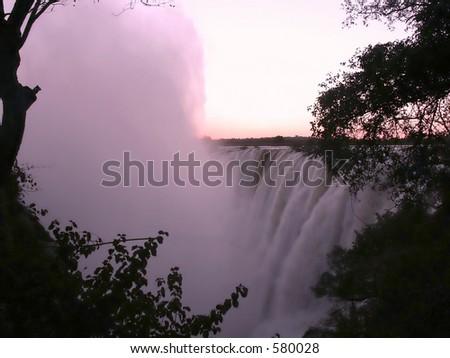 Victoria Falls spray after sundown - stock photo