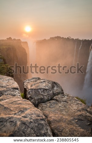 Victoria Falls sunset, View from Zambia with rocks - stock photo
