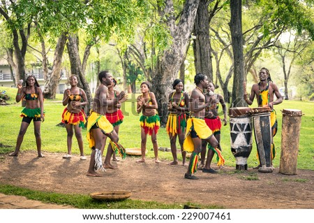 VICTORIA FALLS, ZIMBABWE - NOVEMBER 7, 2014: local people performing traditional ethnic folkloristic dance. In Africa it is one of the most common way to get tipps from tourists - stock photo