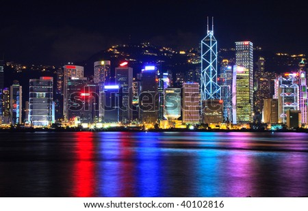 Victoria Harbor and Central district, Hong Kong during late evening.