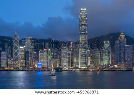 Victoria Harbor in Hong Kong at dusk - stock photo