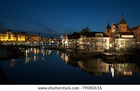Victoria hotel and Centraal Station (1889), Amsterdam, Netherlands - stock photo