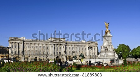Victoria Memorial and Buckingham Palace London, home to the Queen of England. Clear deep blue summer sky. - stock photo