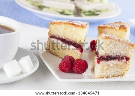 Victoria sponge cake with raspberries for afternoon tea. - stock photo