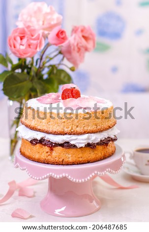 Victoria sponge cake with whipped cream and strawberries - stock photo