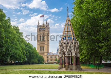 Victoria Tower (Houses of Parliament) and Buxton Memorial Fountain shot from Victoria Tower Gardens, London, UK - stock photo