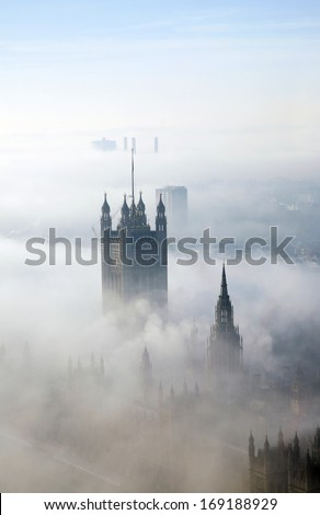 Victoria Tower of Palace of Westminster in fog seen from London Eye   - stock photo