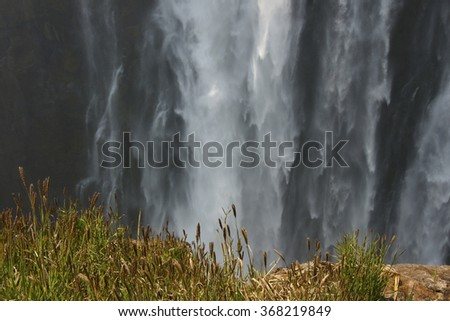 Victoria water falls via the mist and spray famous nature landmark Africa - stock photo