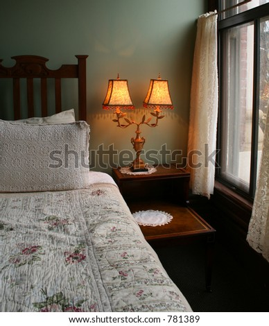 Victorian Bedroom with Bed, Lamp, and Nightstand