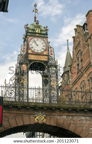 Victorian clock mounted on the city walls at Chester, UK. This public clock was erected in 1897 by public subscription. The coats of arms beneath the clock are all medieval.