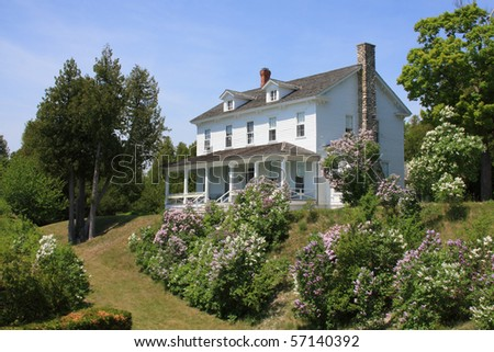 Victorian Era home and garden on a hill - stock photo
