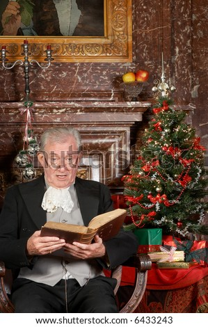 """Victorian grandfather reading the christmas story. Shot in the antique castle """"Den Brandt"""" in Antwerp, Belgium (with signed property release for the Castle interiors). - stock photo"""