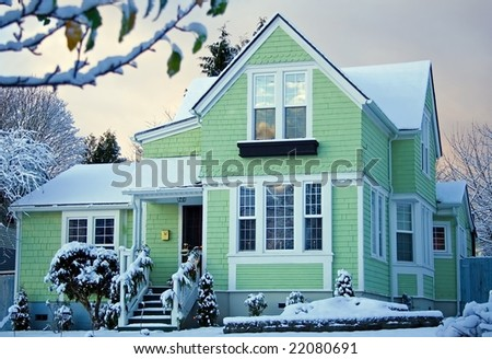 Victorian House At Sunrise With Snow - stock photo